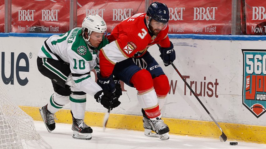 Ty Dellandrea #10 of the Dallas Stars defends against Keith Yandle #3 of the Florida Panthers as he circles behind the net with the puck during first period action at the BB&T Center on Feb. 22, 2021 in Sunrise, Florida.