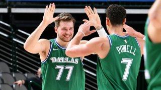 Luka Doncic #77 of the Dallas Mavericks high fives Dwight Powell #7 of the Dallas Mavericks during the game against the Minnesota Timberwolves on Feb. 8, 2021 at the American Airlines Center in Dallas, Texas.