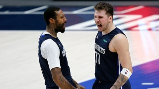 Luka Doncic #77 of the Dallas Mavericks celebrates with James Johnson #16 of the Dallas Mavericks after making the game-winning shot against the Boston Celtics at American Airlines Center on Feb. 23, 2021 in Dallas, Texas.