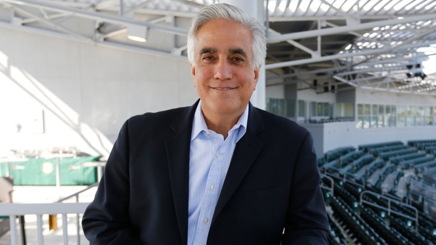 In this March 3, 2015, file photo, Perdo Gomez of ESPN stands in the stands prior to the game between the Oakland Athletics and the San Francisco Giants at Hohokam Stadium in Mesa, Arizona.