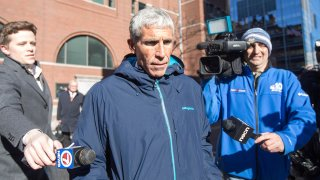 """William """"Rick"""" Singer leaves Boston Federal Court after being charged with racketeering conspiracy, money laundering conspiracy, conspiracy to defraud the United States, and obstruction of justice on March 12, 2019, in Boston."""