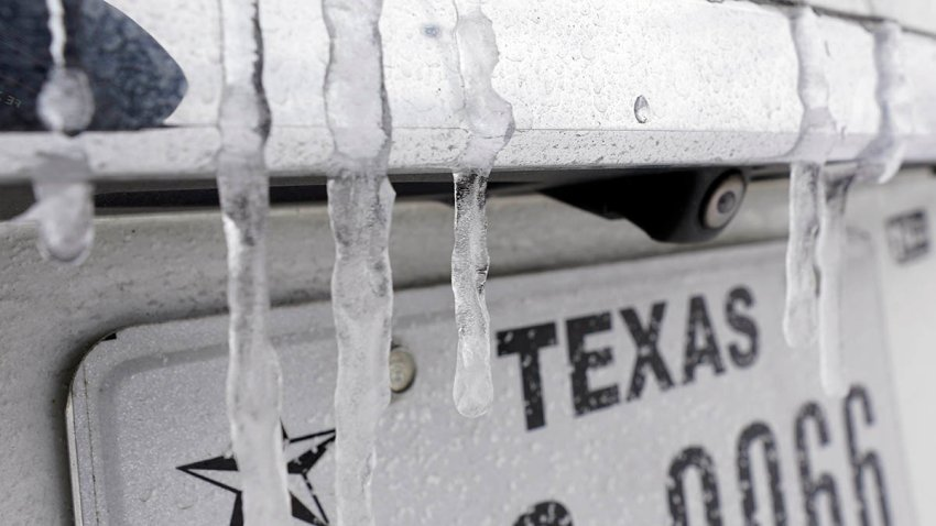 Icicles formed over a vehicle's Texas license plate amid snowstorms and a record-breaking cold snap, Feb. 15, 2021.