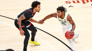 Guard Davion Mitchell #45 of the Baylor Bears handles the ball against guard Kyler Edwards #11 of the Texas Tech Red Raiders during the first half of the college basketball game at United Supermarkets Arena on Jan. 16, 2021 in Lubbock, Texas.