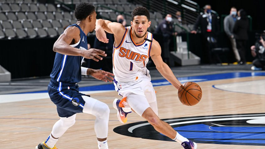Devin Booker #1 of the Phoenix Suns handles the ball during the game against the Dallas Mavericks on Feb. 1, 2021 at the American Airlines Center in Dallas, Texas.