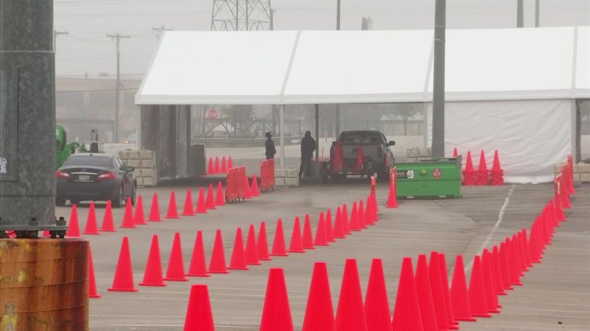 Work is underway Monday morning to prepare the Fair Park COVID-19 vaccination clinic for large volumes of people.