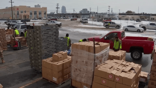 Hundreds of cars were lined up outside of the Tarrant Area Food Bank's distribution center on Thursday waiting for emergency food boxes provided by the food bank.