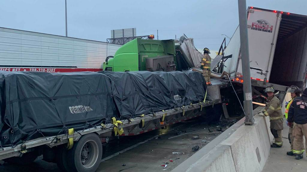 Firefighters respond to a multi-vehicle pileup in Fort Worth Thursday morning after thin sheets of ice formed on North Texas highways overnight.