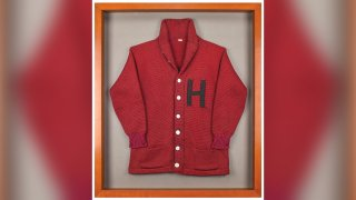 This undated photo released by RR Auction shows a Harvard University letter sweater that once belonged to former President John F. Kennedy, up for auction between Feb. 11-18, 2021, by the Boston-based auction firm.
