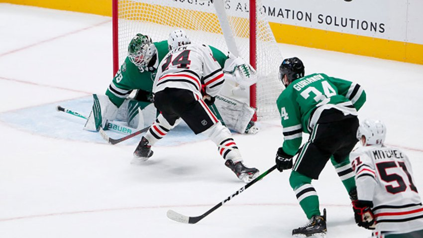 Pius Suter #24 of the Chicago Blackhawks scores the game-winning goal against Jake Oettinger #29 of the Dallas Stars in overtime at American Airlines Center on Feb. 9, 2021 in Dallas, Texas.