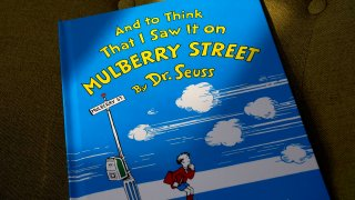 "A copy of the book ""And to Think That I Saw It on Mulberry Street,"" by Dr. Seuss, March 1, 2021, in Walpole, Massachusetts. Dr. Seuss Enterprises, the business that preserves and protects the author and illustrator's legacy, announced on his birthday, March 2, 2021, that it would cease publication of several children's titles including ""And to Think That I Saw It on Mulberry Street"" and ""If I Ran the Zoo,"" because of insensitive and racist imagery."