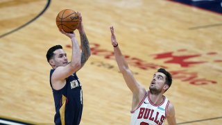 New Orleans Pelicans guard JJ Redick shoots next to Chicago Bulls guard Tomas Satoransky (31) during the first half of an NBA basketball game in New Orleans, Wednesday, March 3, 2021.
