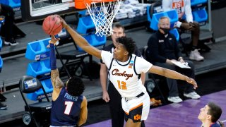 Oklahoma State forward Matthew-Alexander Moncrieffe (12) blocks the shot of Liberty's Chris Parker during the first half of a first round NCAA college basketball game Friday, March 19, 2021, at the Indiana Farmers Coliseum in Indianapolis.