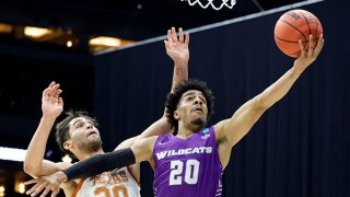 Coryon Mason #20 of the Abilene Christian Wildcats attempts a lay up against the Brock Cunningham #30 of the Texas Longhorns during the second half in the first round game of the 2021 NCAA Men's Basketball Tournament at Lucas Oil Stadium on March 20, 2021 in Indianapolis, Indiana.