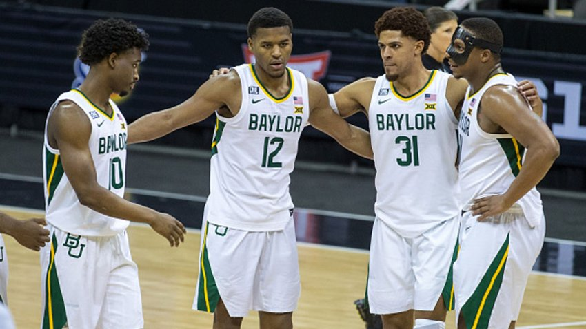 Baylor Bears players gather mid court after winning the game against the Kansas State Wildcats on March 11, 2021 at the T Mobile Center in Kansas City, Missouri.