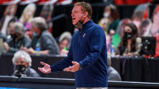 FILE: Head coach Bill Self of the Kansas Jayhawks talks with a player during the first half of the college basketball game against the Texas Tech Red Raiders at United Supermarkets Arena on Dec. 17, 2020 in Lubbock, Texas.