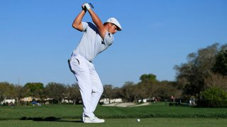 Bryson DeChambeau of the United States plays his shot from the 11th tee during the final round of the Arnold Palmer Invitational Presented by MasterCard at the Bay Hill Club and Lodge on March 7, 2021 in Orlando, Florida.