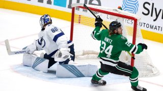 Dallas Stars left wing Roope Hintz (24) turns after scoring against Tampa Bay Lightning goaltender Andrei Vasilevskiy (88) during the third period of an NHL hockey game in Dallas, Thursday, March 25, 2021.