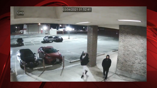 Surveillance footage of two men outside of Altamesa Blvd. game room