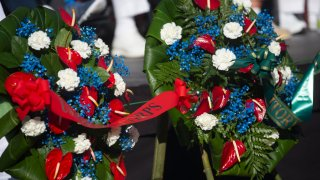 HONOLULU, HI - DECEMBER 07: The service wreath presentation as Pearl Harbor Commemorates the 78th Anniversary Of World War II Attacks at the Pearl Harbor National Memorial on December 7, 2019 in Honolulu, Hawaii. On the morning of December 7, 1941 the Japanese mounted a surprise military air strike on the naval base at Pearl Harbor leading to the United States' formal entry into World War II the next day. 2,335 were killed in the attack and dozens of naval ships were damaged or sunk.