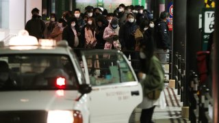 people wait for taxis around Sendai Station