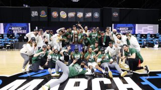 The Baylor Bears celebrate their win over the Arkansas Razorbacks in the Elite Eight round of the 2021 NCAA Division I Men's Basketball Tournament held at Lucas Oil Stadium on March 29, 2021 in Indianapolis, Indiana.