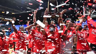 The Houston Cougars celebrate their victory over the Oregon State Beavers in the Elite Eight round of the 2021 NCAA Division I Men's Basketball Tournament held at Lucas Oil Stadium on March 29, 2021 in Indianapolis, Indiana.