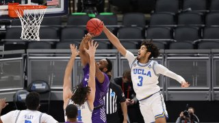 Johnny Juzang #3 of the UCLA Bruins blocks a shot against the Abilene Christian Wildcats in the second round of the 2021 NCAA Division I Men's Basketball Tournament held at Bankers Life Fieldhouse on March 22, 2021 in Indianapolis, Indiana.