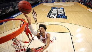 Justin Smith #0 of the Arkansas Razorbacks drives to the basket against Terrence Shannon Jr. #1 of the Texas Tech Red Raiders during the first half in the second round game of the 2021 NCAA Men's Basketball Tournament at Hinkle Fieldhouse on March 21, 2021 in Indianapolis, Indiana.