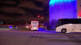 Several buses arrived at the Kay Bailey Hutchison Convention Center late Wednesday in Dallas under escort by federal vehicles.