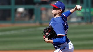 Starting pitcher Kyle Gibson #44 of the Texas Rangers pitches against the San Francisco Giants during the first inning of the MLB spring training game on March 1, 2021 in Surprise, Arizona.