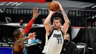 Luka Doncic #77 of the Dallas Mavericks shoots the ball during an NBA game against the Portland Trail Blazers at Moda Center on March 21, 2021 in Portland, Oregon.