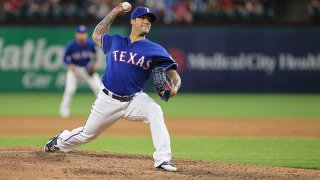 Texas Rangers pitcher Matt Bush (51) delivers a pitch during the game between the Texas Rangers and the Oakland Athletics on April 24, 2018 at Globe Life Park in Arlington, Texas.