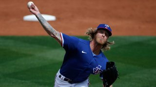 Starting pitcher Mike Foltynewicz #20 of the Texas Rangers throws against the Los Angeles Dodgers during the second inning of the MLB spring training baseball game at Surprise Stadium on March 7, 2021 in Surprise, Arizona.