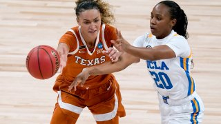 UCLA guard Charisma Osborne (20) passes under pressure from Texas guard Celeste Taylor during the first half of a college basketball game in the second round of the women's NCAA tournament at the Alamodome in San Antonio, Wednesday, March 24, 2021.