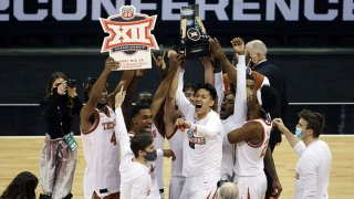 The Texas Longhorns celebrate after defeating the Oklahoma State Cowboys 91-86 to win the Big 12 Basketball Tournament championship game at the T-Mobile Center on March 13, 2021 in Kansas City, Missouri.