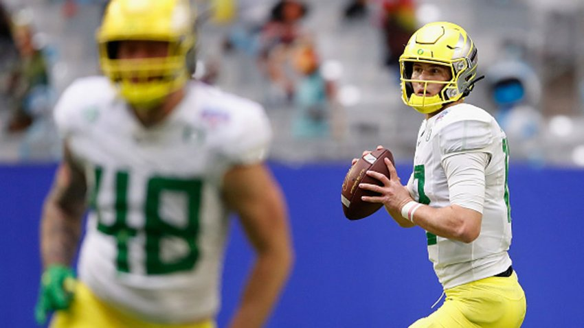 Quarterback Tyler Shough #12 of the Oregon Ducks drops back to pass during the first half of the PlayStation Fiesta Bowl against the Iowa State Cyclones at State Farm Stadium on Jan. 2, 2021 in Glendale, Arizona. The Cyclones defeated the Ducks 34-17.