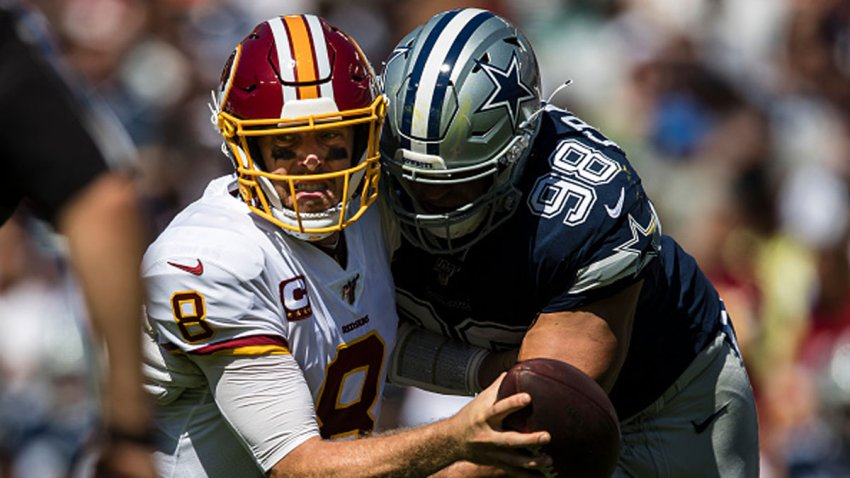 Tyrone Crawford #98 of the Dallas Cowboys sacks Case Keenum #8 of the Washington Redskins during the first half at FedExField on Sept. 15, 2019 in Landover, Maryland.