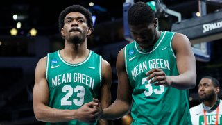 Mykell Robinson #23 and Abou Ousmane #33 of the North Texas Mean Green react after losing to the Villanova Wildcats in their second round game of the 2021 NCAA Men's Basketball Tournament at Bankers Life Fieldhouse on March 21, 2021 in Indianapolis, Indiana.