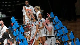 Oklahoma State players cheer from the bench during the first half of a game against Wake Forest in the first round of the women's NCAA tournament at the Greehey Arena in San Antonio, Texas, March 21, 2021.