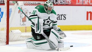 Dallas Stars goalie Anton Khudobin (35) makes a stop during the first period of the National Hockey League game between the Dallas Stars and Detroit Red Wings on March 20, 2021 at Little Caesars Arena in Detroit, Michigan.