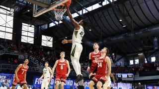 Davion Mitchell #45 of the Baylor Bears goes for a lay-up during the second half against the Wisconsin Badgers in the second round game of the 2021 NCAA Men's Basketball Tournament at Hinkle Fieldhouse on March 21, 2021 in Indianapolis, Indiana.