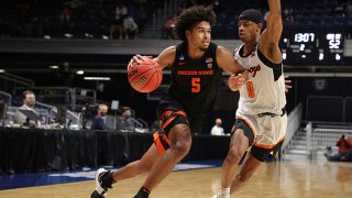 Ethan Thompson #5 of the Oregon State Beavers drives against Avery Anderson III #0 of the Oklahoma State Cowboys during the second half in the second round game of the 2021 NCAA Men's Basketball Tournament at Hinkle Fieldhouse on March 21, 2021 in Indianapolis, Indiana.