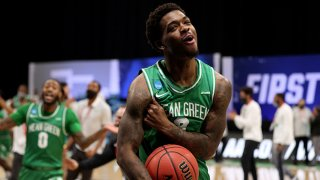 Javion Hamlet #3 of the North Texas Mean Green celebrates after defeating the Purdue Boilermakers in the first round of the 2021 NCAA Division I Mens Basketball Tournament held at Lucas Oil Stadium on March 19, 2021 in Indianapolis, Indiana.