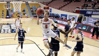 Mac McClung #0 of the Texas Tech Red Raiders drives to the basket during the first half against the Utah State Aggies in the first round game of the 2021 NCAA Men's Basketball Tournament at Assembly Hall on March 19, 2021 in Bloomington, Indiana.