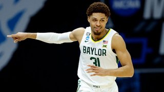 MaCio Teague #31 of the Baylor Bears reacts after a play against the Hartford Hawks in the first round game of the 2021 NCAA Men's Basketball Tournament at Lucas Oil Stadium on March 19, 2021 in Indianapolis, Indiana.