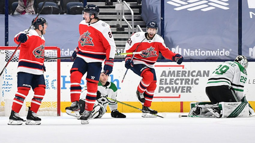 Cam Atkinson #13 of the Columbus Blue Jackets, left, Zach Werenski #8 of the Columbus Blue Jackets, middle and Oliver Bjorkstrand #28 of the Columbus Blue Jackets all celebrate Werenski's overtime goal against the Dallas Stars at Nationwide Arena on March 13, 2021 in Columbus, Ohio. Columbus defeated Dallas 4-3 in overtime.