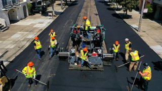 workers with the San Francisco Department of Public Works repave
