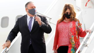 Secretary of State Mike Pompeo, and his wife Susan disembark from an aircraft upon their arrival at the airport in New Delhi, India, Monday, Oct. 26, 2020.