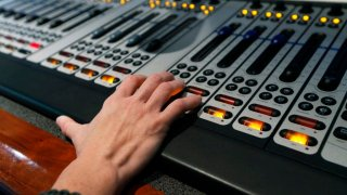 A hand on top of a sound board