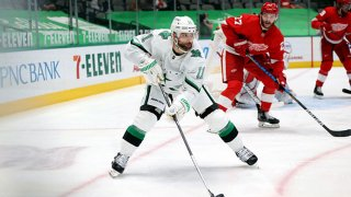 Andrew Cogliano #11 of the Dallas Stars skates the puck against the Detroit Red Wings in the second period at American Airlines Center on April 20, 2021 in Dallas, Texas.
